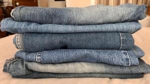 Stacks of old denim jeans