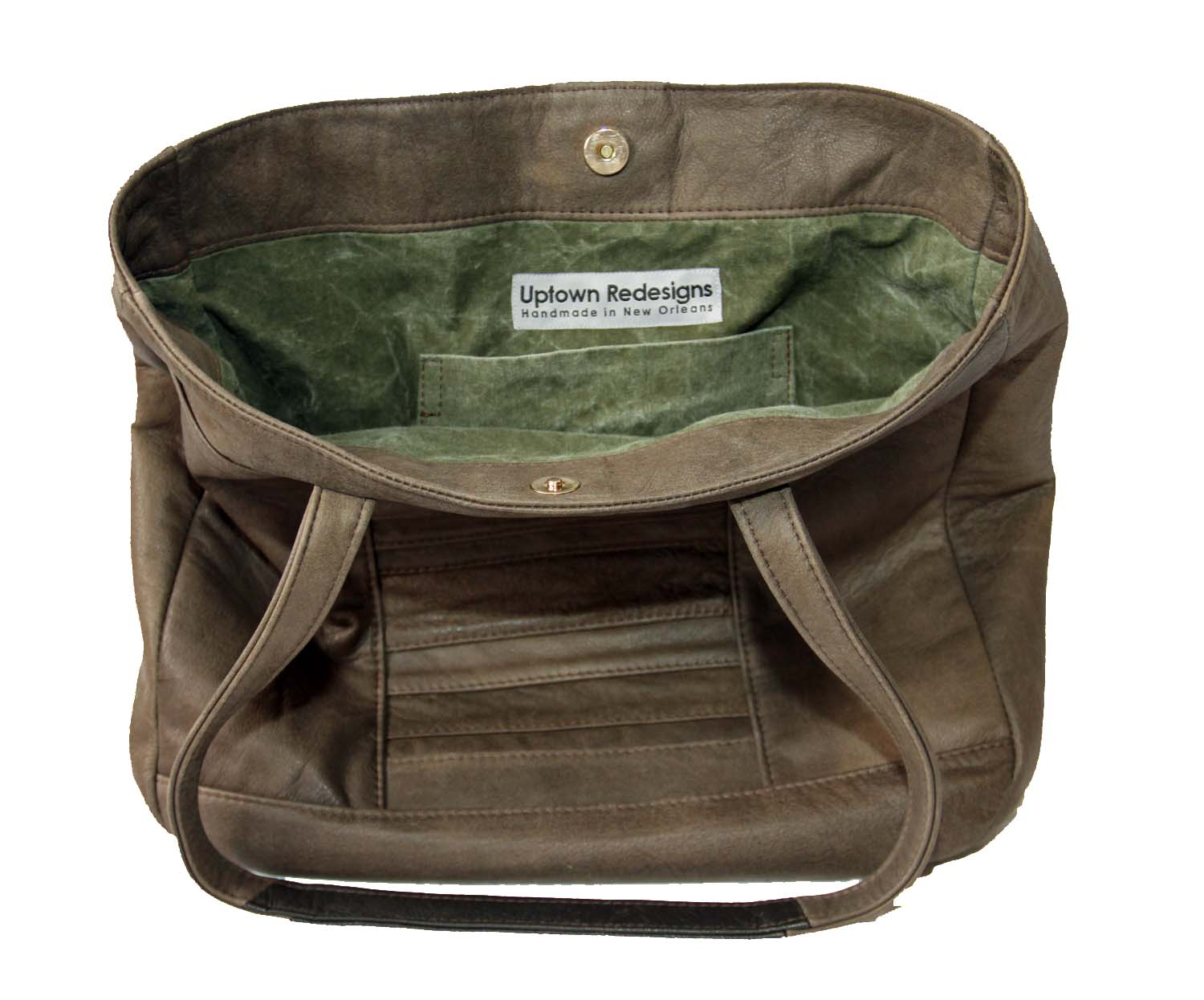 Interior of an upcycled leather bag.  The lining is made of US Army Tent canvas.